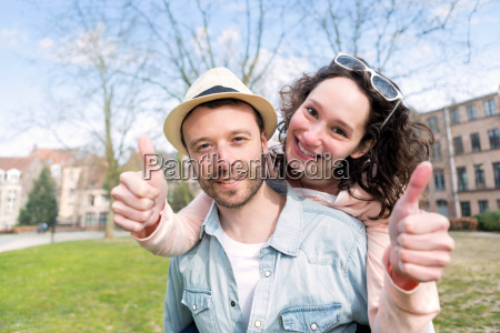 young happy couple having fun on