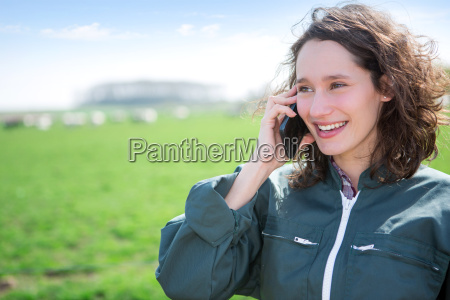 young attractive farmer in a field