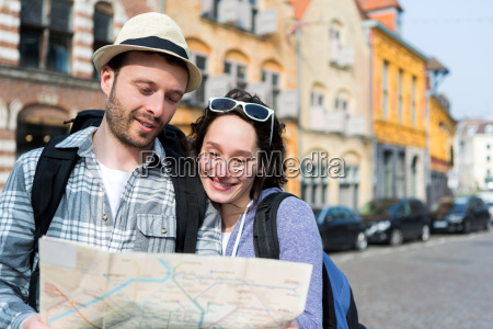 couple, of, young, attractive, tourists, watching - 14176249