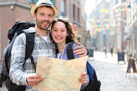 couple, of, young, attractive, tourists, watching - 14176297