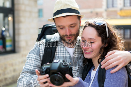 young, couple, of, tourist, watching, photographs - 14176267