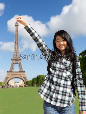 young attractive asian tourist in front