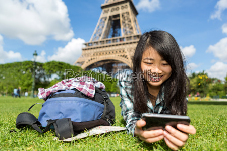 young attractive asian tourist smartphone tablet