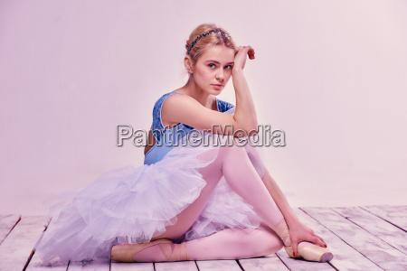 tired ballet dancer sitting on the