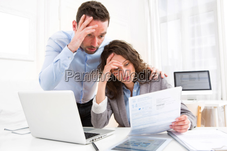young attractive couple doing paperwork