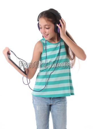 beautiful pre teen girl using a