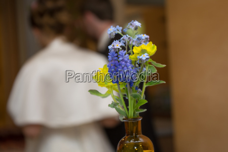 small bouquet with bride and groom