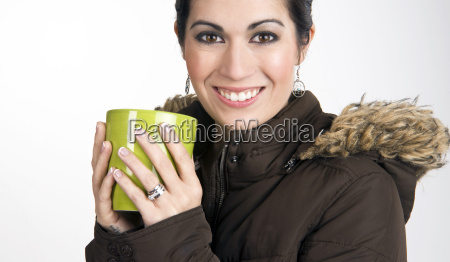 winter cup woman wearing coat snuggles