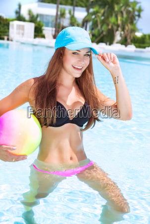 happy girl in swimming pool