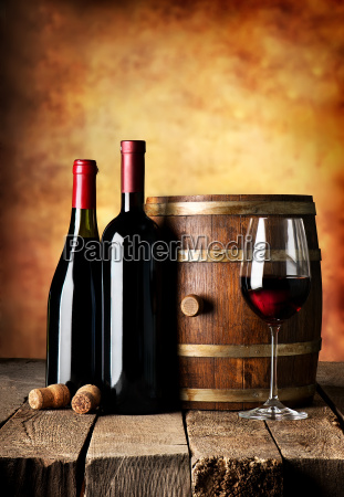 bottles and cask of wine