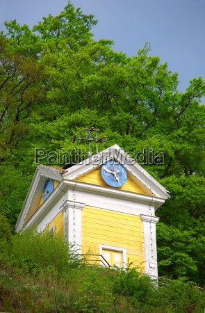 yellow chapel on the mountain in