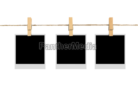 blank photo frame on cloth line