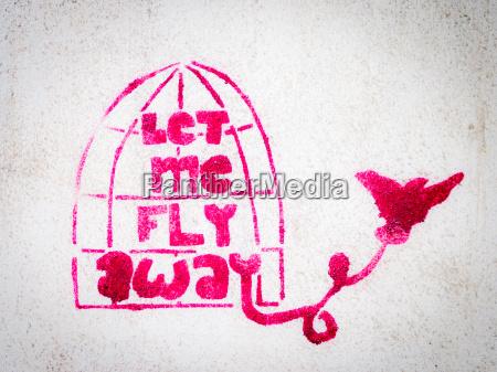 pink stencil graffiti with bird leaving