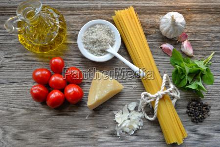 pasta tomato parmesan on wooden background