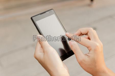 closeup hand using smartphone mobile