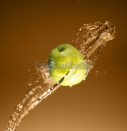 green apple with water splash on