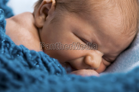 newborn infant baby wrapped naked in