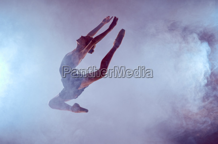 beautiful young ballet dancer jumping on