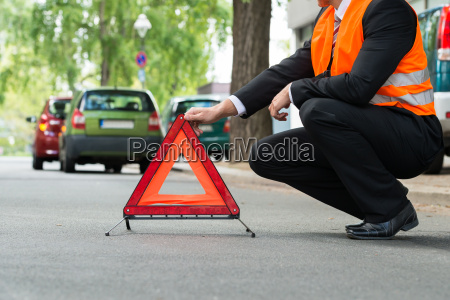 red warning triangle with a broken