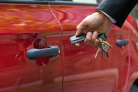 man opening the car door with