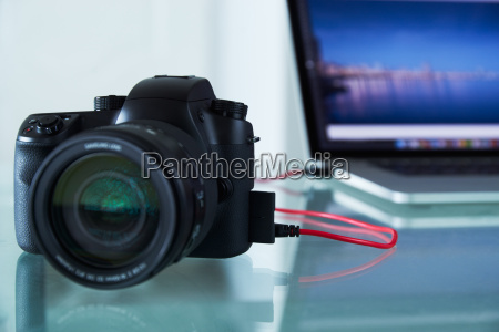 dslr photo camera tethered to laptop