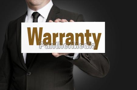 warranty shield is held by businessman