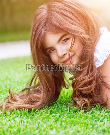 cute girl on green grass