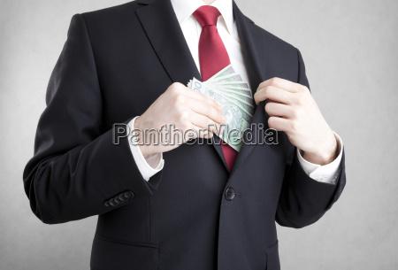 corruption man putting polish money in