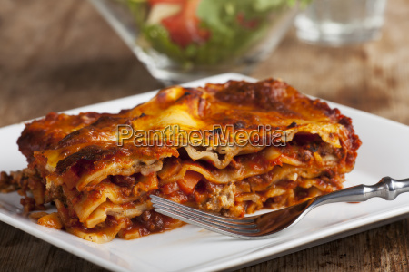 homemade lasagna on rustic wood