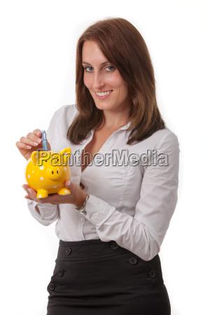 business frau mit einem sparschwein