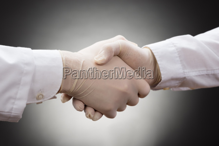 two doctors shaking hand