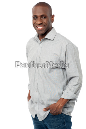 smiling man posing in casuals