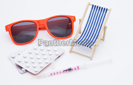 sunbed with syringe and tablets
