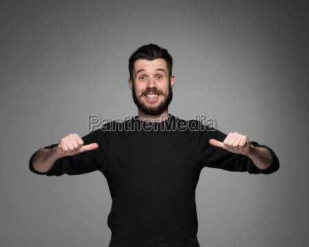 young man pointing himself