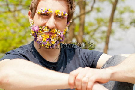 hipster self confident man flowers covered