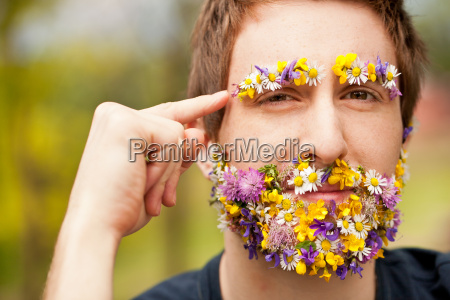 hipster face covered with flowers thinking