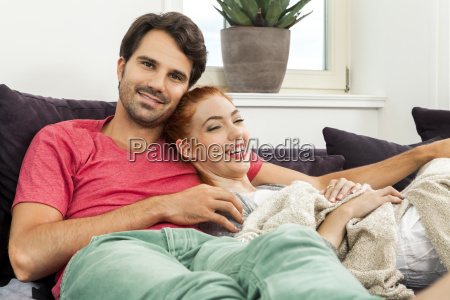 young loving couple in living room