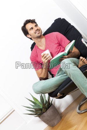young man in leisure clothes relaxes