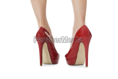 attractive female legs with red stilettos