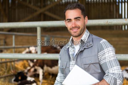young attractive farmer in a barn
