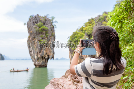 women tourist shooting natural view by