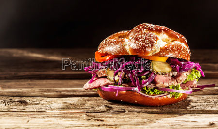 delicious burger with rare roast beef