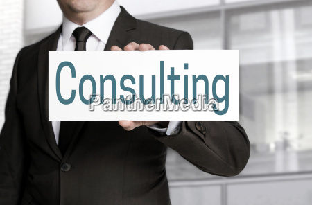 consulting shield is held by businessman