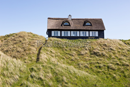 thatched cottage on the dunes