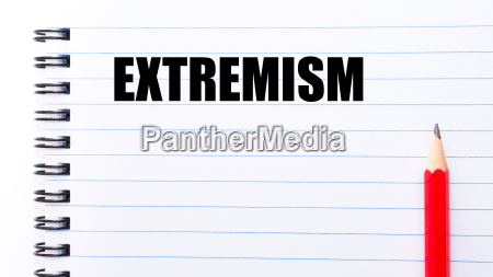 word extremism written on notebook page