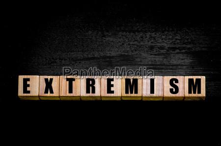 word extremism isolated on black background
