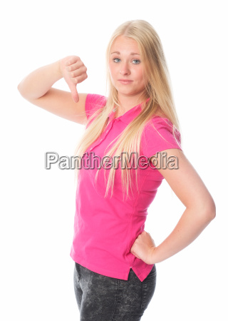 blond young girl showing thumbs down