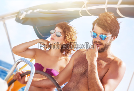happy lover driving sailboat
