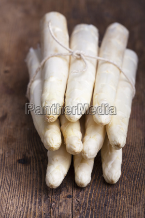 bunch of raw asparagus on wood