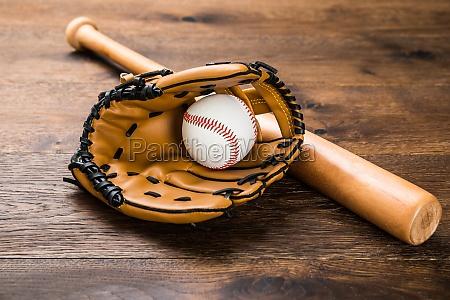 glove with baseball and bat